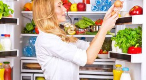 woman-getting-eggs-refrigerator