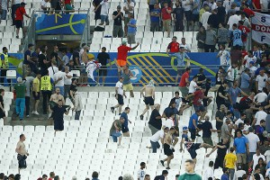 Football Soccer - England v Russia - EURO 2016 - Group B - Stade Vélodrome, Marseille, France - 11/6/16 England fans try to escape trouble in the stadium at full time REUTERS/Eddie Keogh Livepic