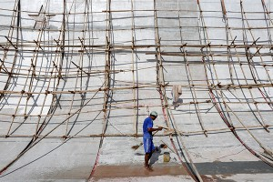 epa05377219 A builder works on Martyrs' Mausoleum during the renovation ahead of the 69th Martyrs' Day in Yangon, Myanmar, 19 June 2016. Myanmar Martyrs' Mausoleum was built at the foot of holy Shwedagon pagoda to pay respects to the country's nine independence heroes, including General Aung San, the father of opposition leader Aung San Suu Kyi. Myanmar's Martyr's Day is public holiday observed on 19 July to commemorate those who were assassinated on that day in 1947.  EPA/LYNN BO BO
